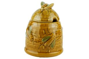 forest honey in rustic ceramic beehive